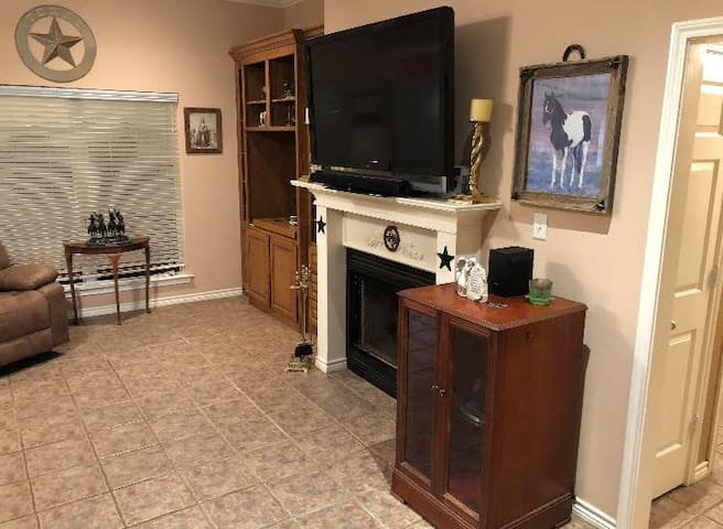"""Living Room has a wood burning fireplace and 55 """" TV.  Sofa and Love seats are the ultimate in comfort with reclining mechinisms."""