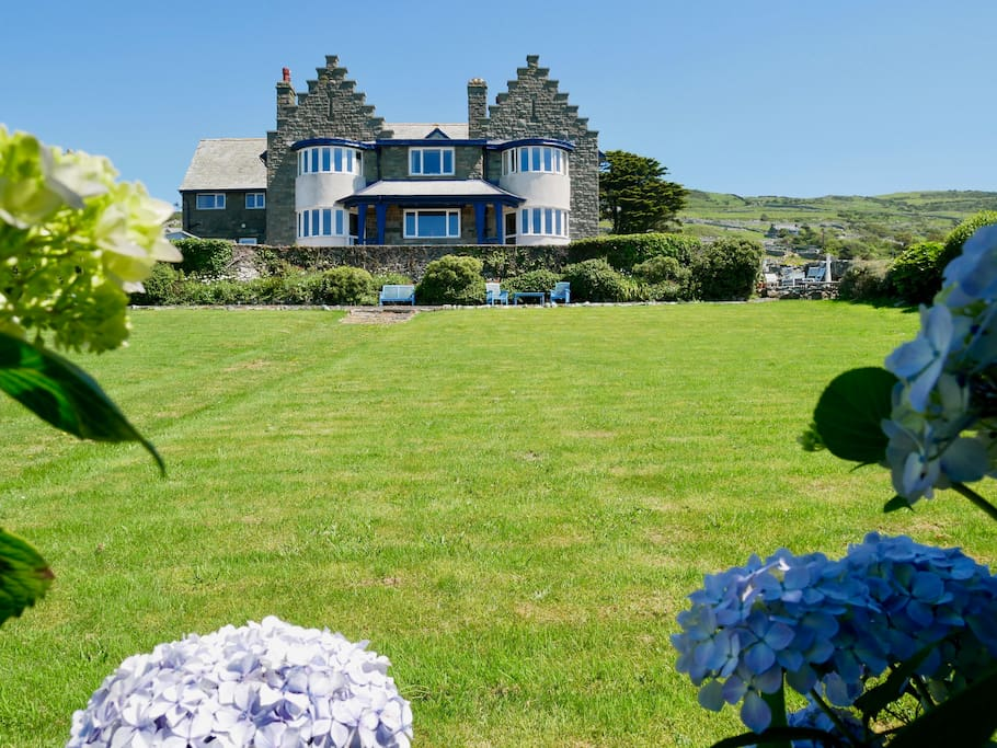 Our Beach House from the bottom of the garden - your Seaview Suite is in the top 2 windows far left of the picture