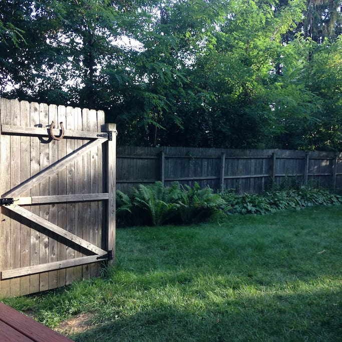 Private fenced-in backyard.