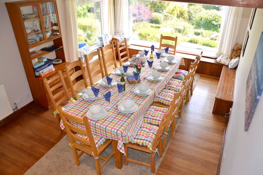 Lovely dining room seats 12. High chair available