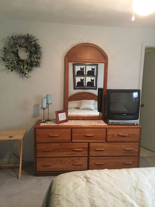 Bureau in queen bedroom with TV