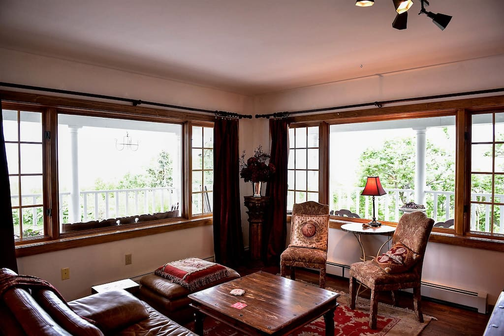 The sitting area has fine furniture and large windows with great views of lake Superior and Madeline Island