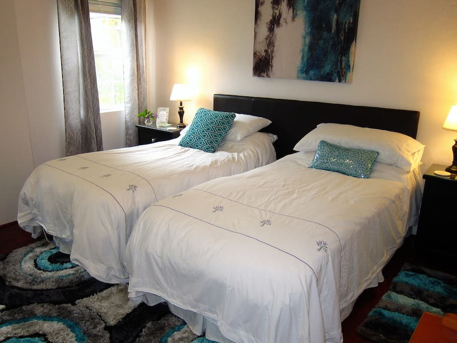 Room can either be set up as 2 twin beds or as a king-size bed