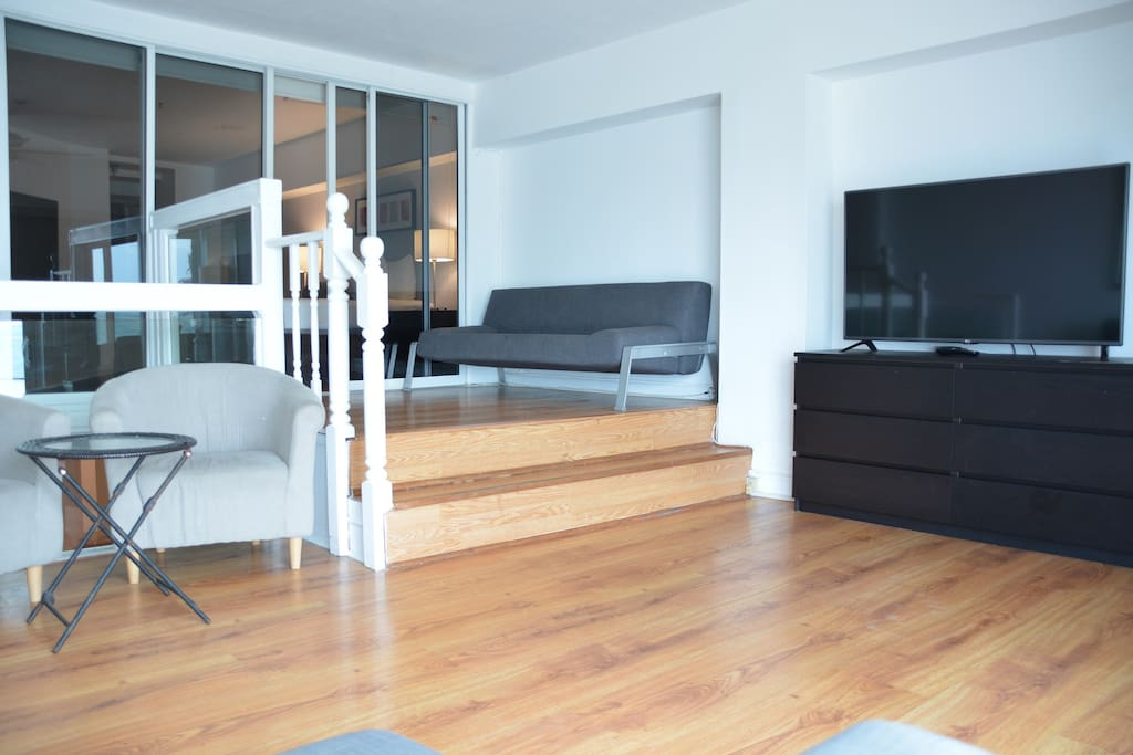 This duplex apartment features lovely decor and minimalist touches.