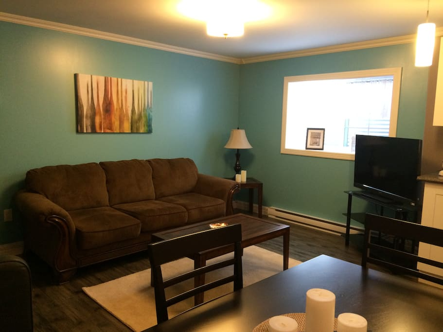 The living room is bright and cheerful with a TV provided, Satellite package included.