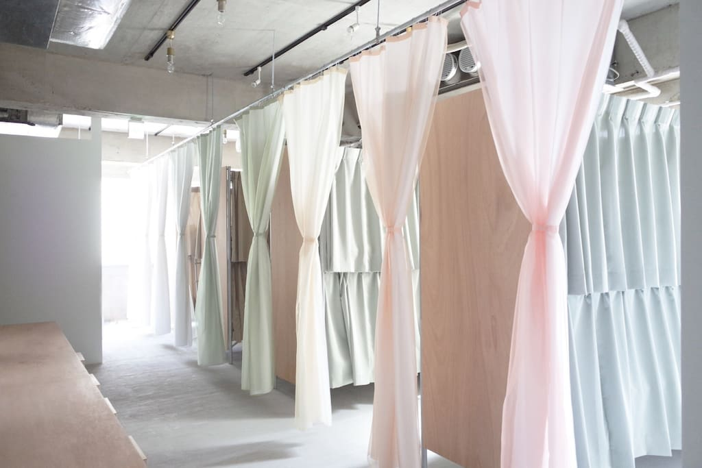 a dorm with curtains to isolate rooms