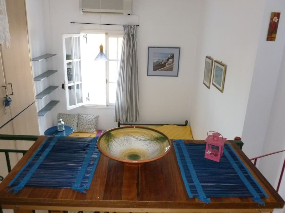 View of the dining table towards the double bed area