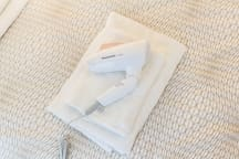 Hair dryer + clean towels and bedsheets for guests