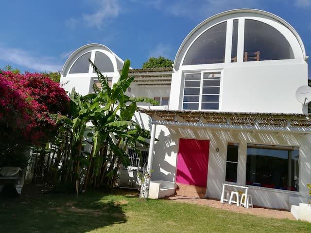 exterior facade with shaded pergola