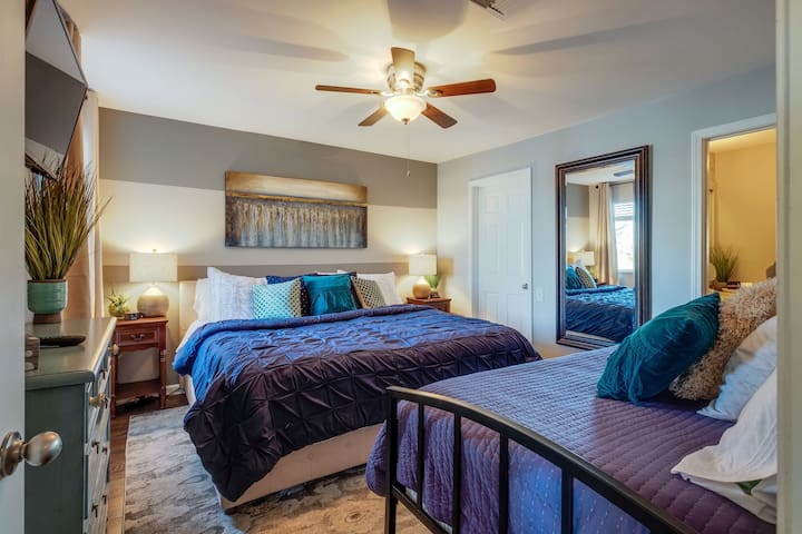 Bedroom 2 - Option 1 set up as a King bed, note that Bdrm 2also has 1 twin bed for additional guest or child. This one also connects to Jack 'n Jill ensuite with separate shower/tub combo and extra large mirror for many to get ready for the day.