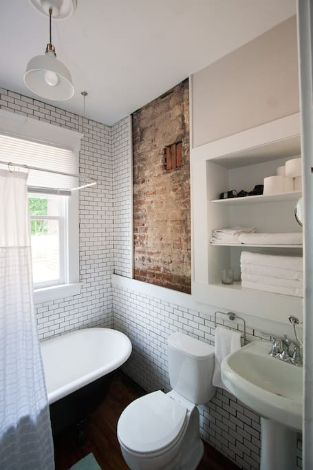 Newly renovated bathroom with claw foot tub, great for soaking!