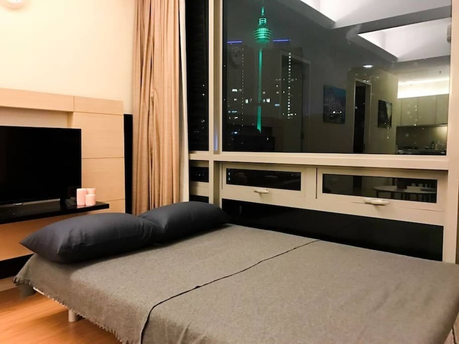 Sofa bed and the KL night view