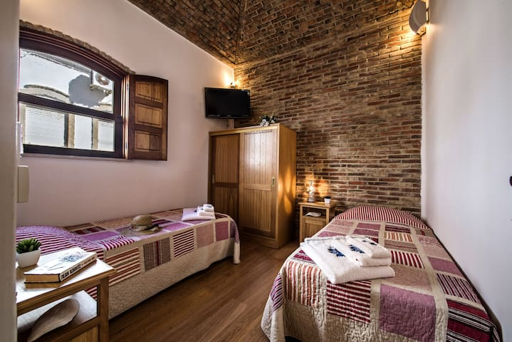 The twin bedroom offers comfortable single beds