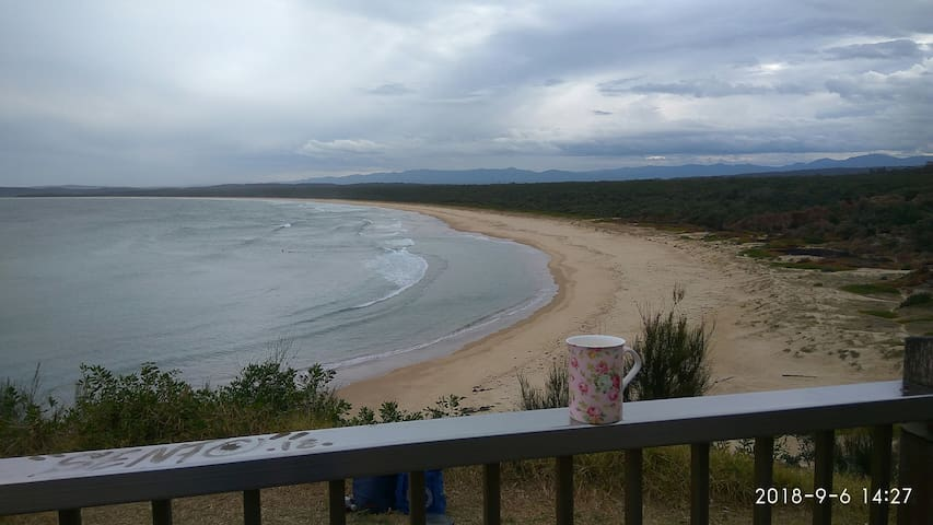 Have the beach to yourself. Photo, Broulee lookout. Beach patrolled in Summer