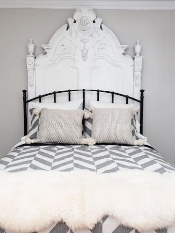 Top quality linens await in your queen bed.  A Victorian siren watches over you from the 8 foot high headboard!