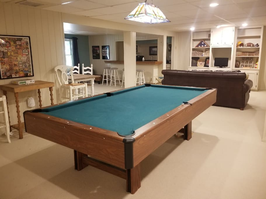 Play a game of pool or enjoy games or movies located in the cabinets