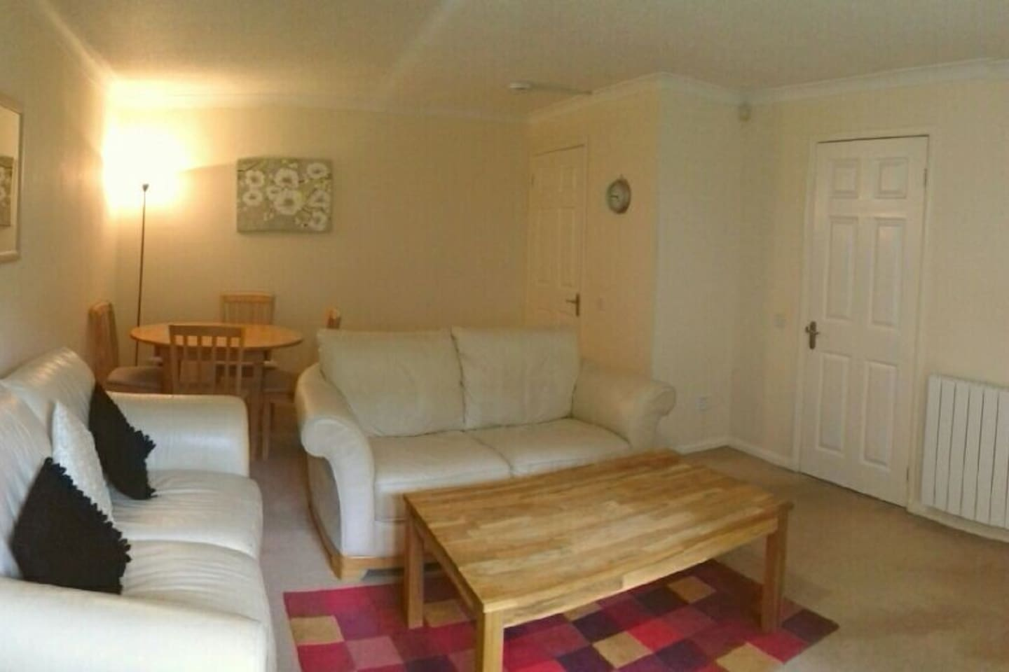 Spacious living room with direct access to the patio outside looking onto the large communal gardens.