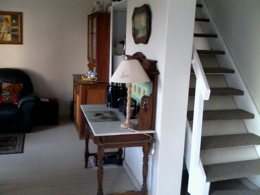 living area downstairs and staircase