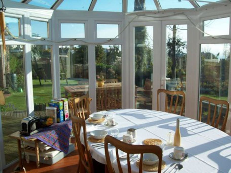 Breakfast is served in the conservatory with views over the garden and to the sea beyond