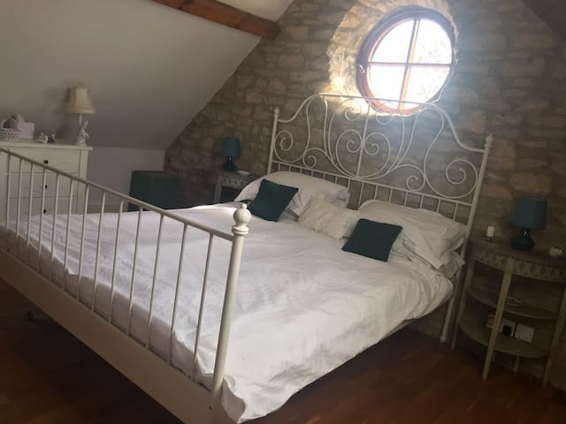 The bedroom with king-size bed & sloping roof