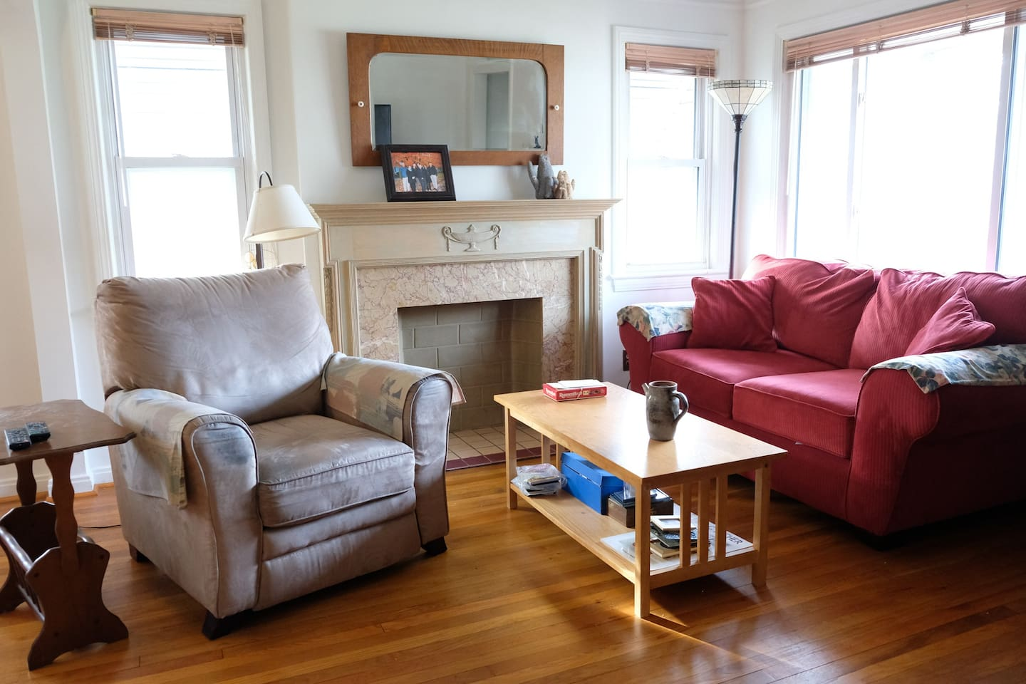 Sunny living room with internet ready TV and seating for at least 4. Also includes a dining room table that seats 4.