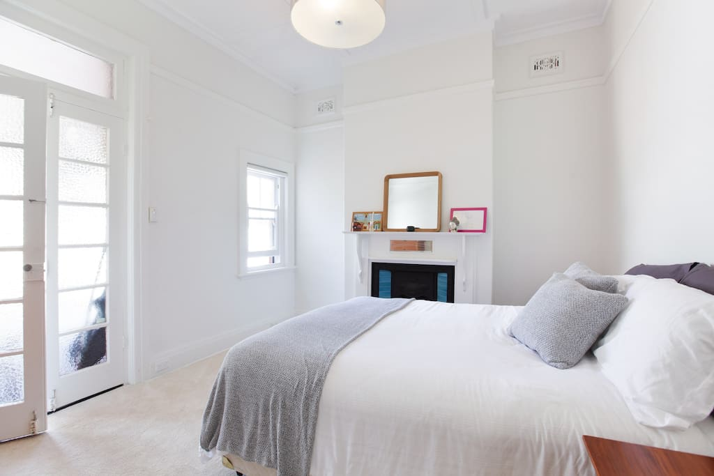 Bright master bedroom with heritage fireplace