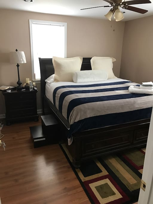 Comfortable King size bed with a step-stool to assist you, bed sits high. Also has a mini-fridge.