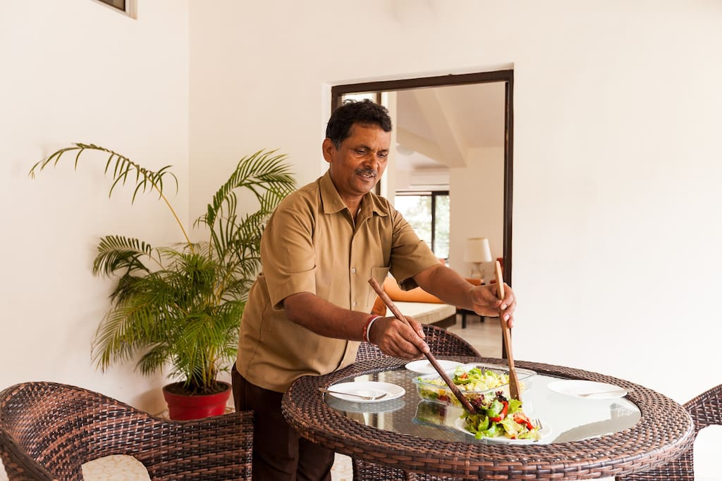 Your dedicated cook preparing a salad on the entrance patio, a great place to hang out