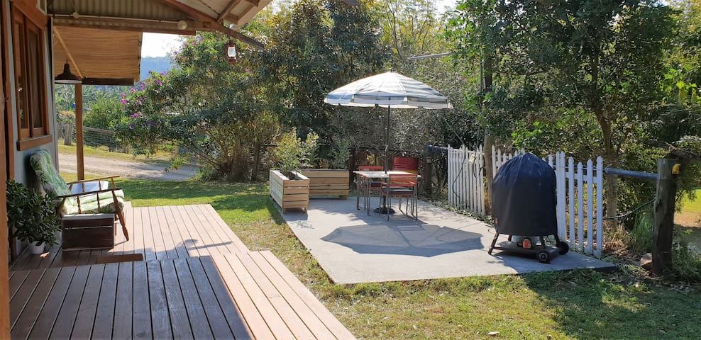 Outdoor sitting area with BBQ.