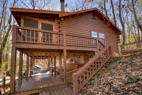 Laughing Hippo is a classic mountain cabin that sleeps 4 with large decks and a hot tub!