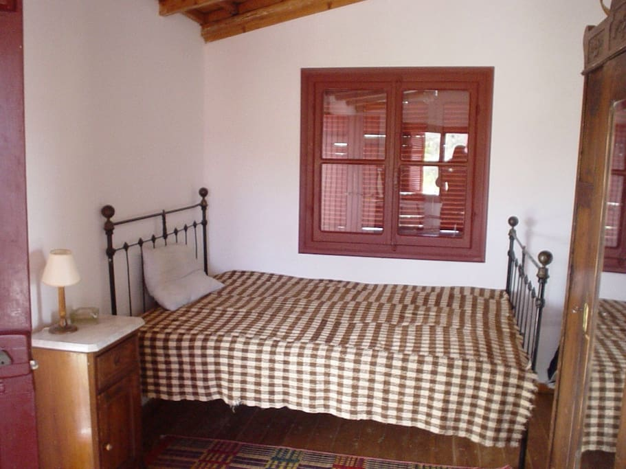 central big bedroom with lovely antique furniture and great sea view!