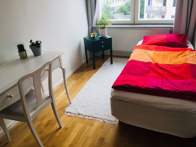 Cosy room in central apartment
