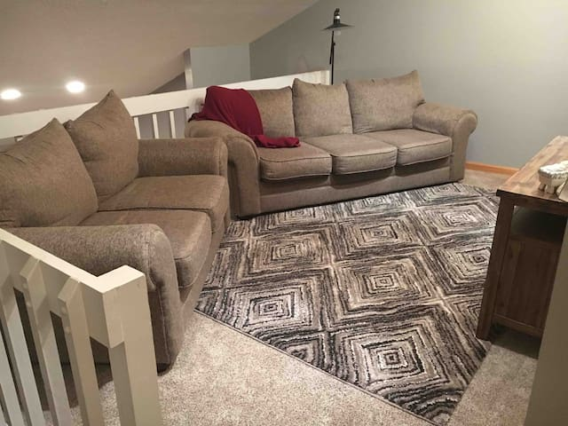 Private living space with: couch, loveseat, and T.V.