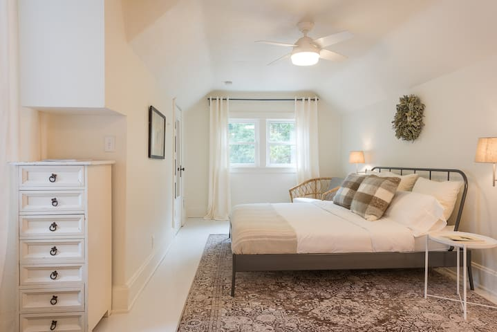 2nd bedroom is upstairs with a king size Leesa bed. The room is large and has an extra sleeping nook (great for kids).