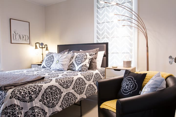 Enjoy this modern bedroom with a queen sized bed and seating.