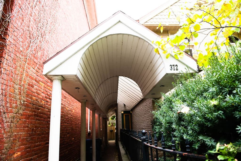 Enter down the covered walkway, and enter the door on the right.