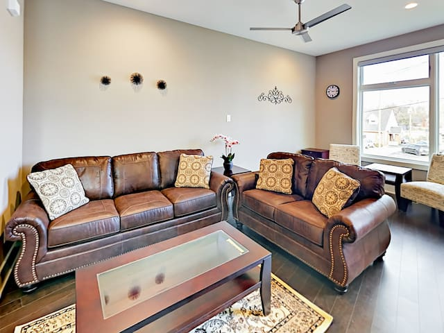 A leather sleeper sofa and matching love seat offer plenty of comfy seating in the main living area.