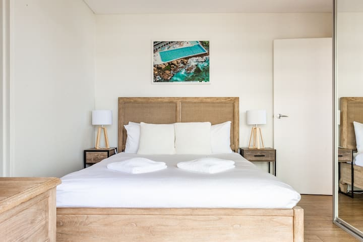 In the bedroom, a queen sized bed is fitted with a plush mattress and luxury linens, guaranteeing a good night's rest.