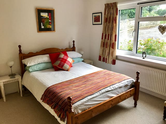 Spacious light double room in village location