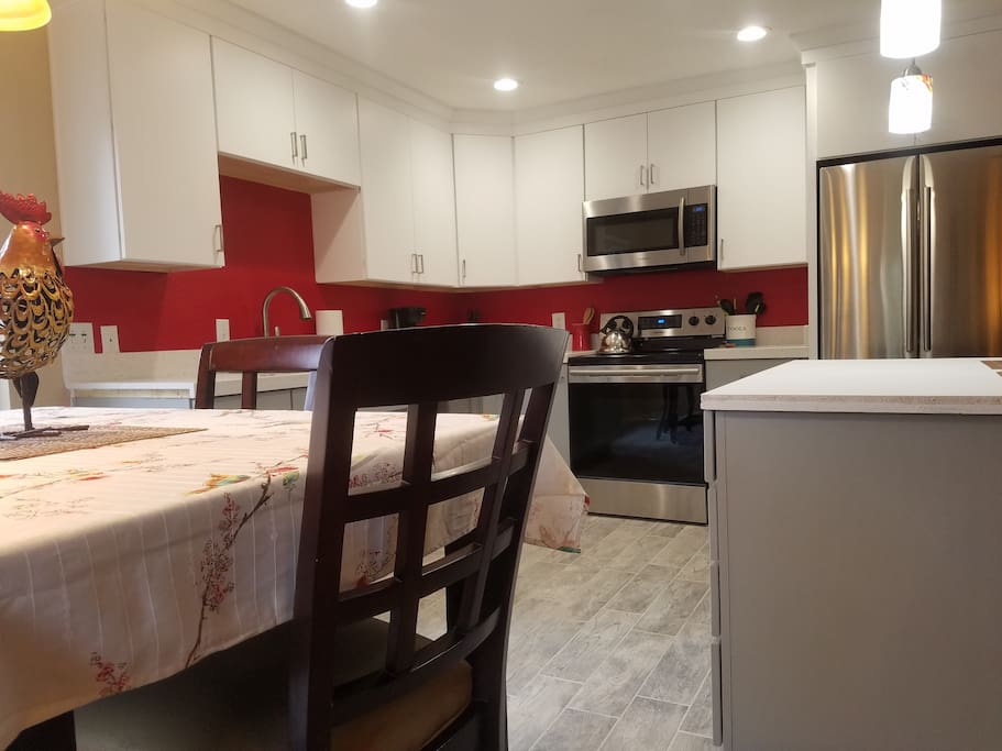 Choy's Place! Check out this gorgeous newly remodeled kitchen! Lots of upgrades including new tile, new cabinets, new center island, all stainless appliances and gorgeous stainless sink! This is a chef's kitchen for sure!