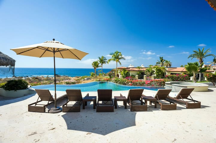 Soak up the warm Cabo sun while reclining on one of the many lounge chairs found on the villa's spacious terrace!