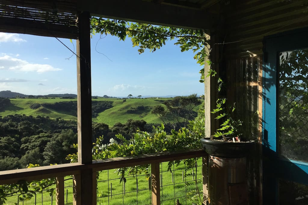 Rolling green hills, the vista as you relax on the deck