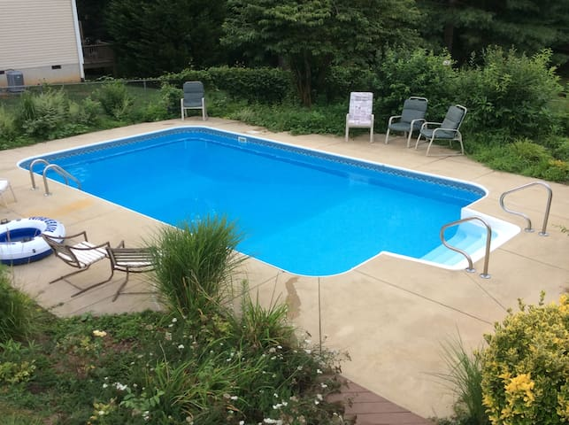 Welcome to our home where you can relax around the 16 x 28' inground pool