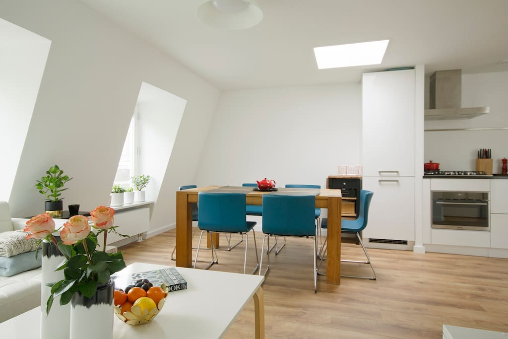 The skylights and big windows provide a lot of light inside the apartment.