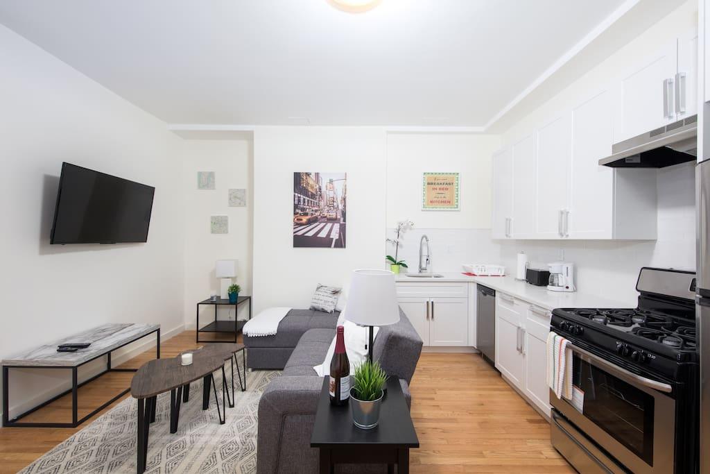 Living room and kitchen Salón y cocina americana