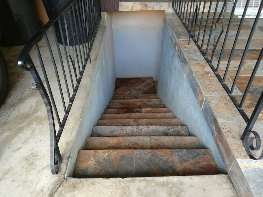 The stairs down to the condo entrance