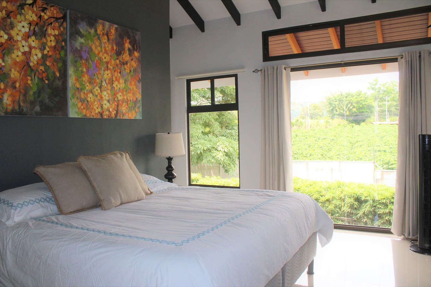 King size Bed with a marvelous view, AC and Kitchenette.