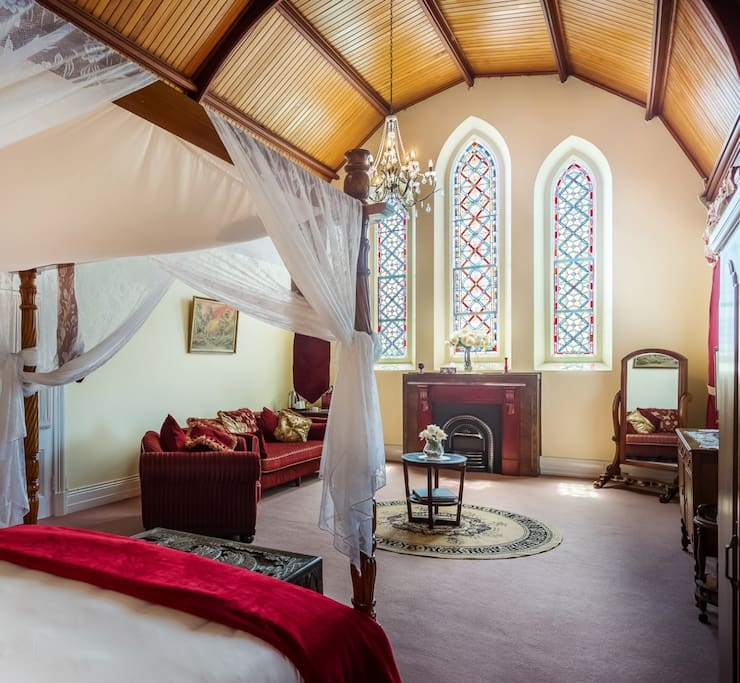 Room 7 -  Bavarian Room.  Original stain glass, king four poster, ensuite, air, private veranda. Boutique heritage accommodation Warwick QLD.