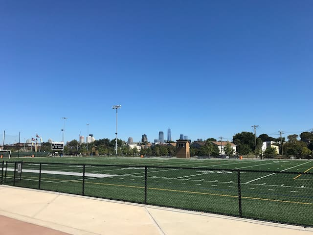 Workout and have fun in Berry Lane Park with views of Manhattan