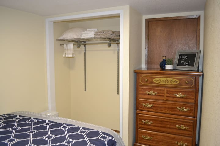 Open closet with hangers and extra warm blankets & full size dresser for your belongings